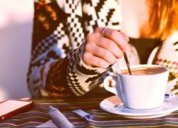 woman hand stirring coffee