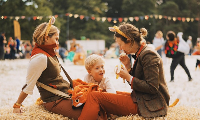 two women with a child at a festival