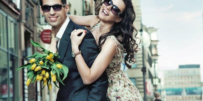 smiling woman hugging a man