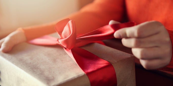 hand opening a present