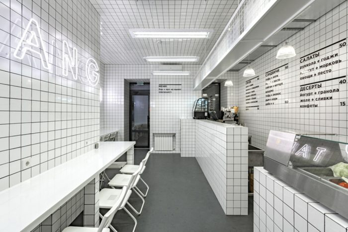 minimalist all white cafe