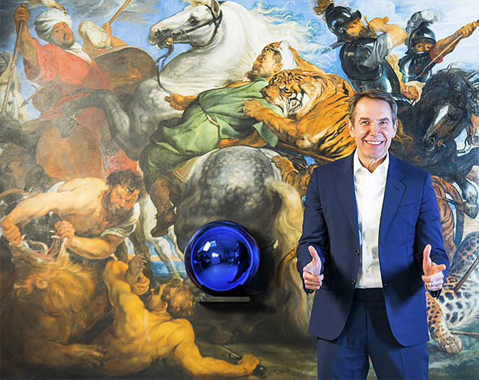 jeff koons in front of his artwork