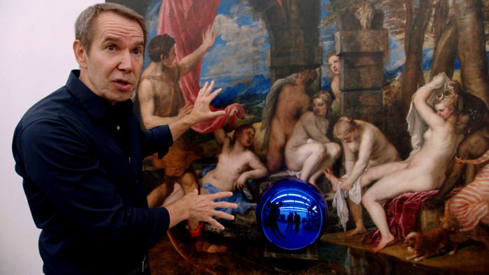 jeff koons in front of his work