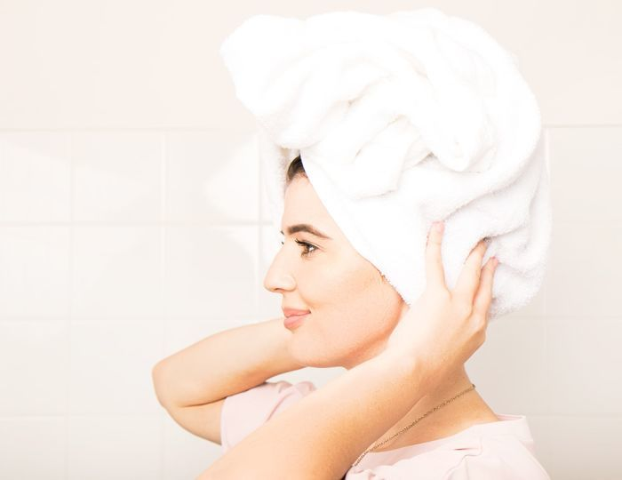 woman with hair towel