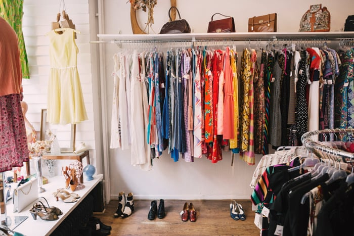second hand stores with colorful vintage clothes on display