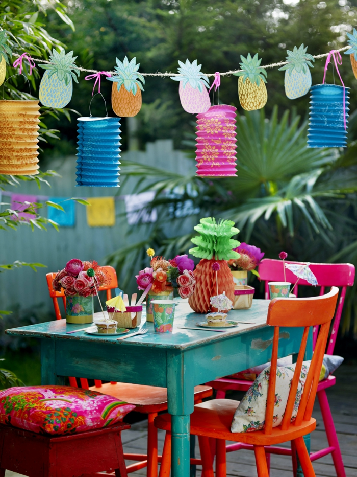 outdoor table with tropical themed decor