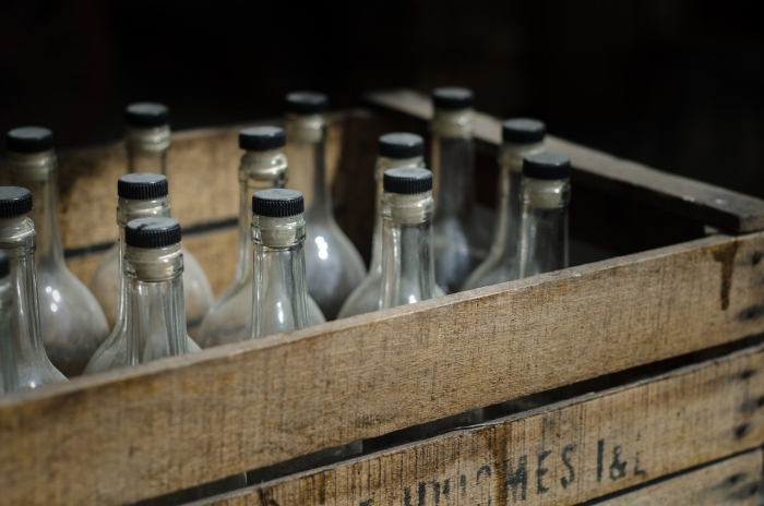Glass bottles in a wooden box