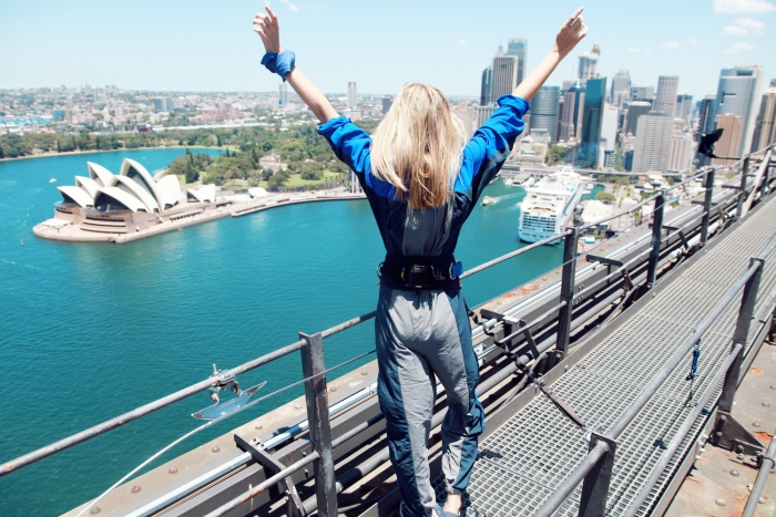 Woman conquering fear bungee jumping