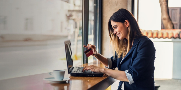 Happy woman shopping online with her credit card