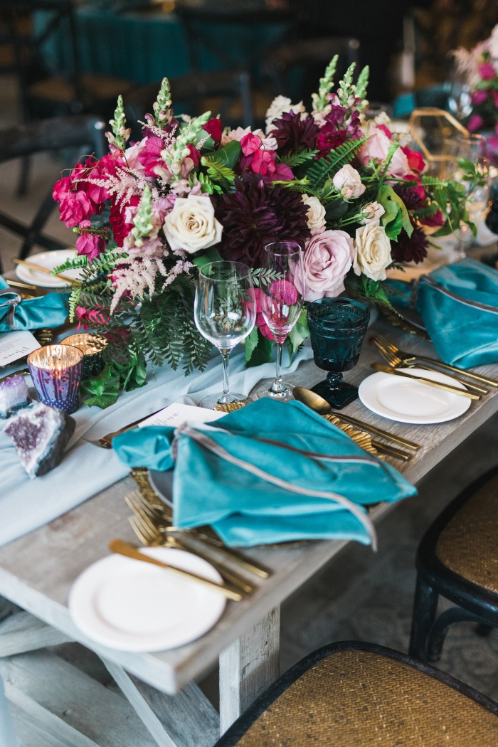 Fall wedding table with jewel tones flowers and golden cutlery