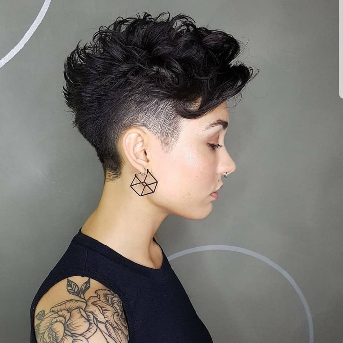 woman profile black top artistic earrings and curly undercut pixie