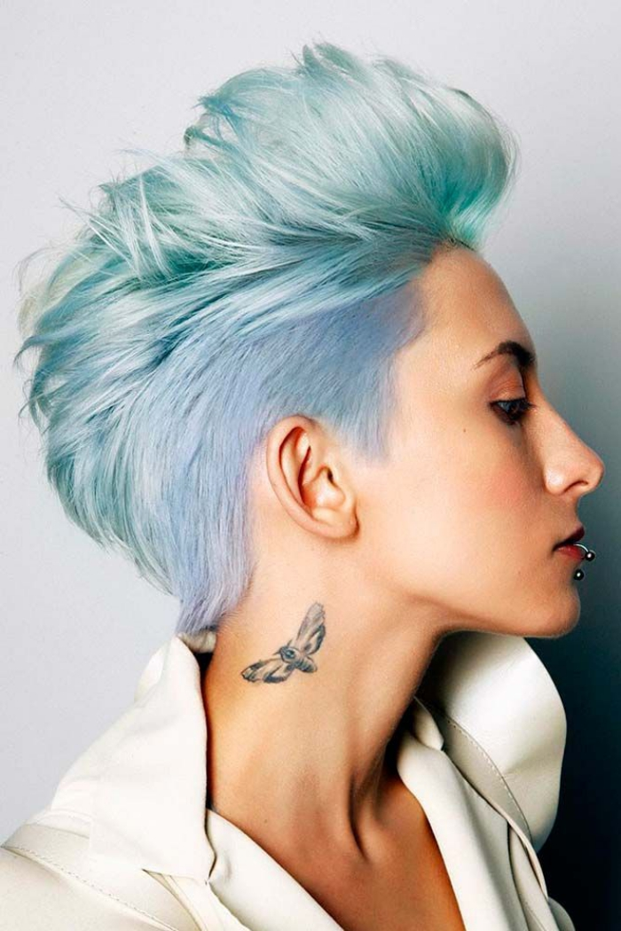 woman profile light blue pixie haircut neck tattoo
