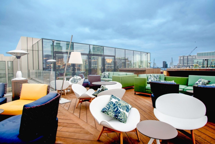 Aviary restaurant london city glass terrace with colorful seats