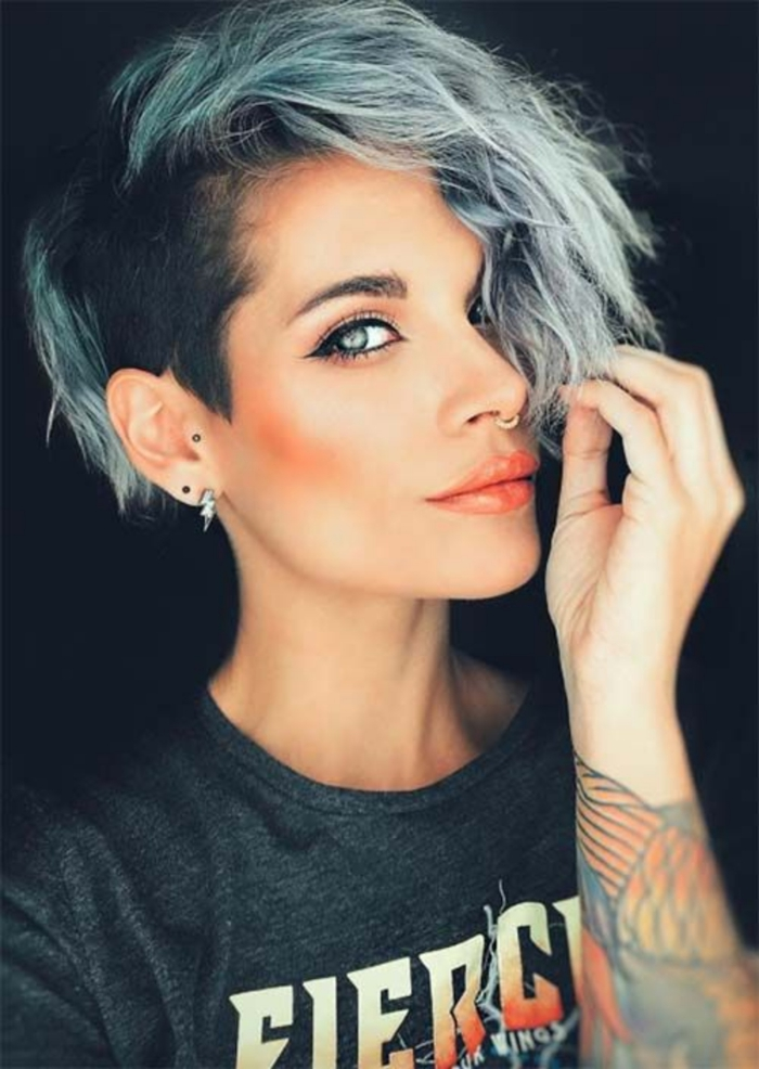 woman with light eyes short green pixie haircut