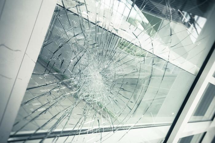 Broken window with white frame