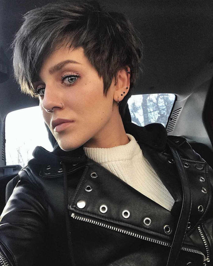 Woman in car with leather jacket and short pixie hair