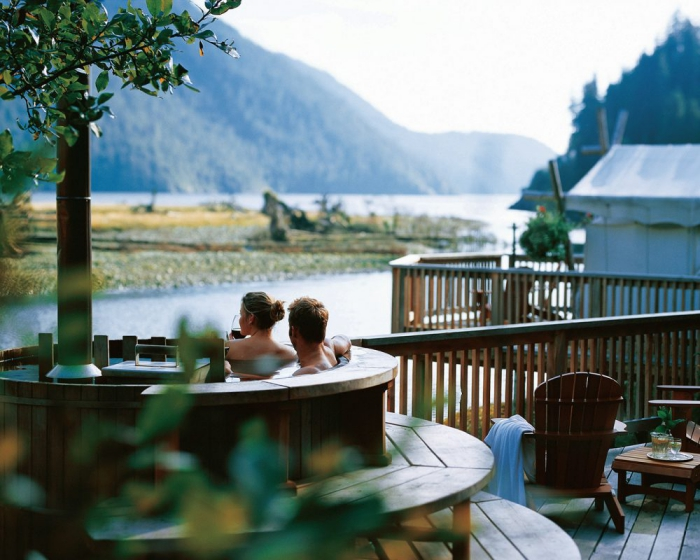 Clayoquot Wilderness Resort Luxury hotel outdoor view couple in Jacuzzi