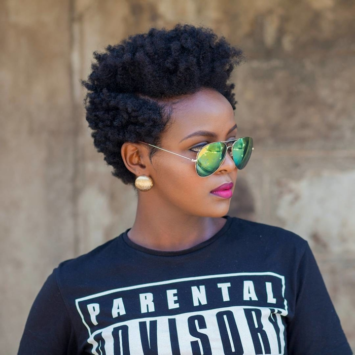 Woman with short curly hair and sunglasses outdoors