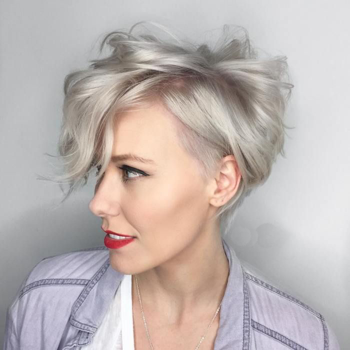 Woman with curl pixie white hair and red lipstick close up