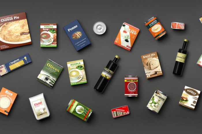 Different packaged food items on grey background