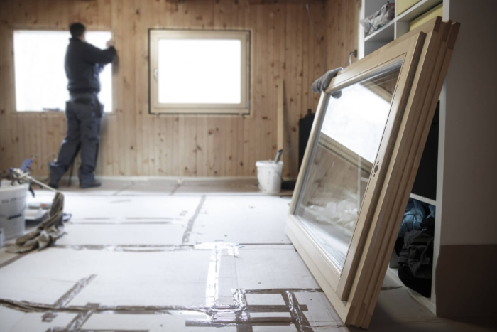 Man replacing old windows with energy-efficient new windows