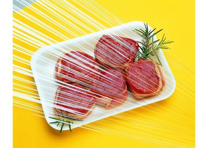 steaks wrapped in plastic foil