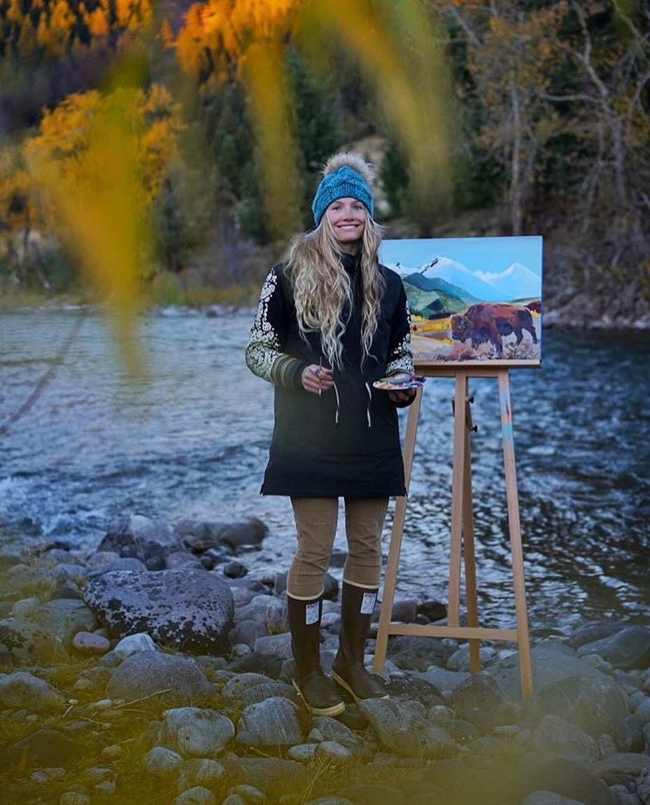 Rachel Pohl painting outdoors on a river bank