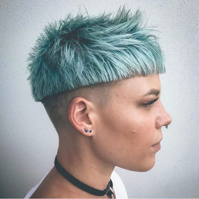 woman profile shart cut short light blue pixie