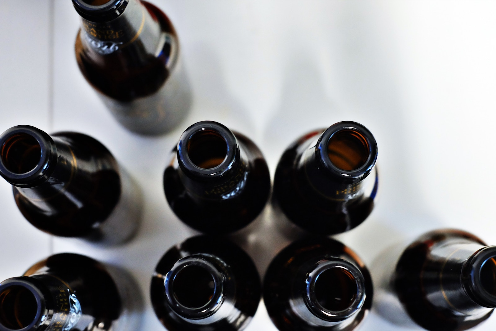 close up dark beer bottles from above