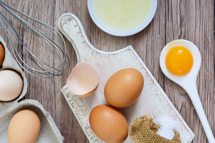 close up eggs in kitchen setting cutting board