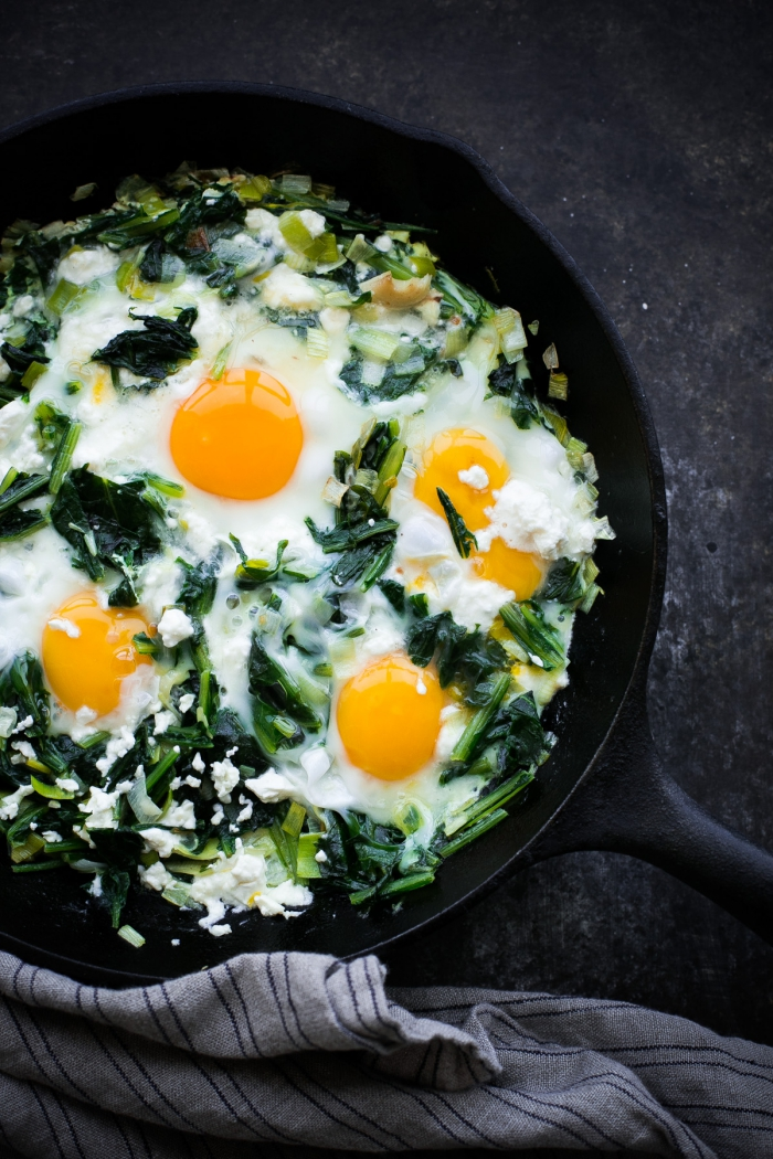 Preparing the healthiest eggs in pan with fried spring onions