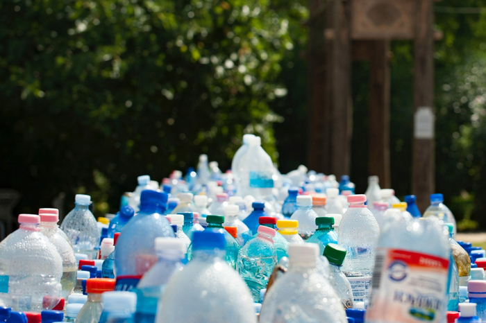 many plastic bottles with colorful caps outdoors