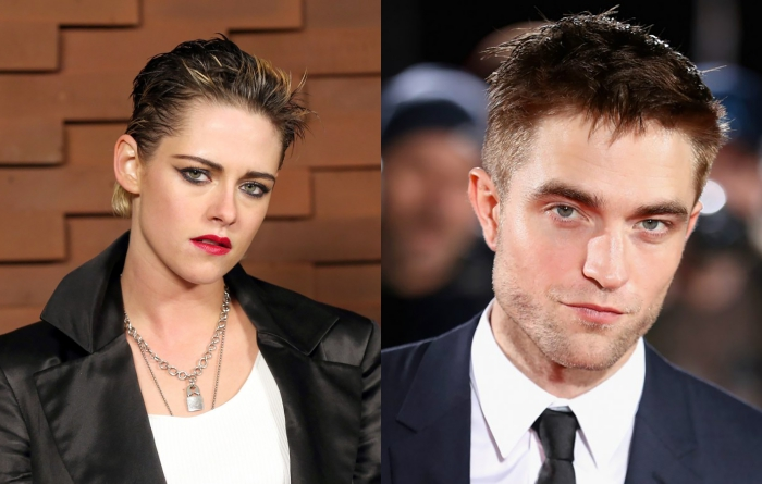 Kristen Stewart and Robert Pattison in dark clothes looking at the camera