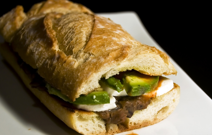 Mexican sandwich  with meat and avocado close up