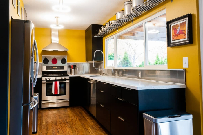 Modern designed kitchen with big windows