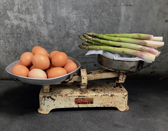 eggs and asparagus on vintage weighing scales