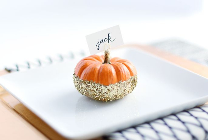 pumpkin place sign on a white plate gold glitter