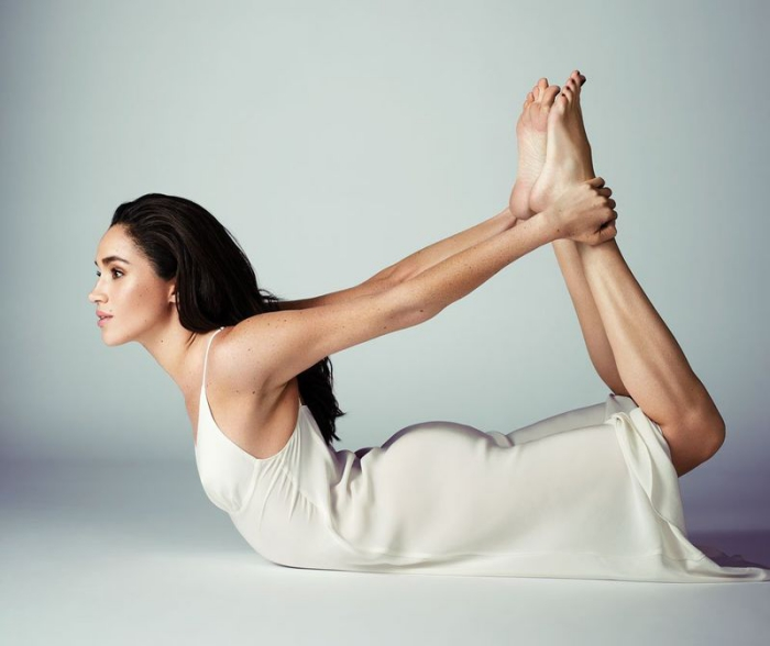 Meghan Markle on white background with white dress yoga position