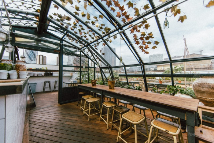 Rooftop restaurant interior glass roof and bar