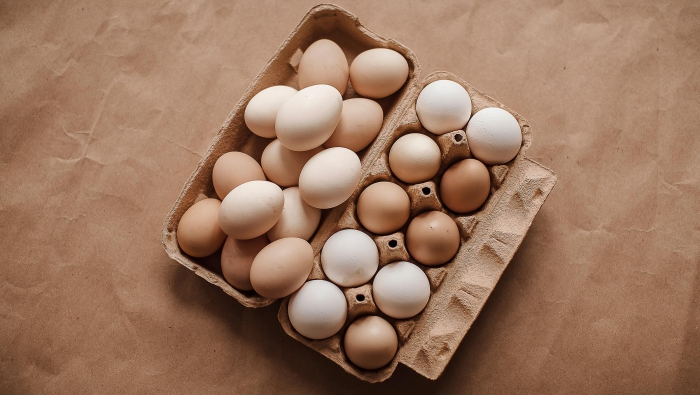 cardboard box of eggs in different shades of brown