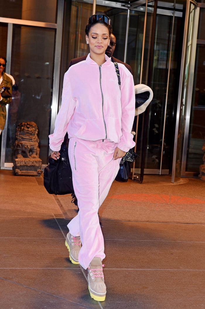 Rihanna in pink velour sportswear walking