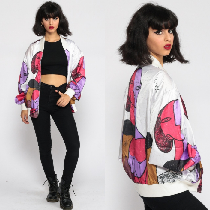 retro model with colorful bomber jacket black jeans black crop top