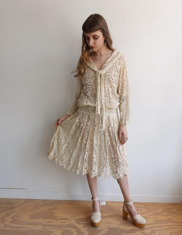 woman in white vintage dress from Lace inspired from the 80s retro fashion