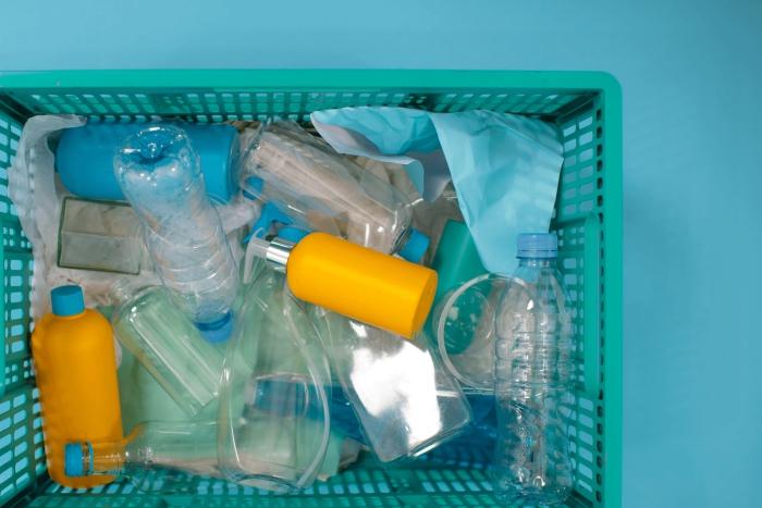 plastic container full of empty plastic bottles