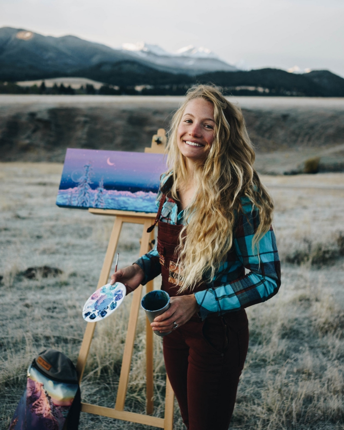 Artist Rachel Pohl painting outdoors smiling