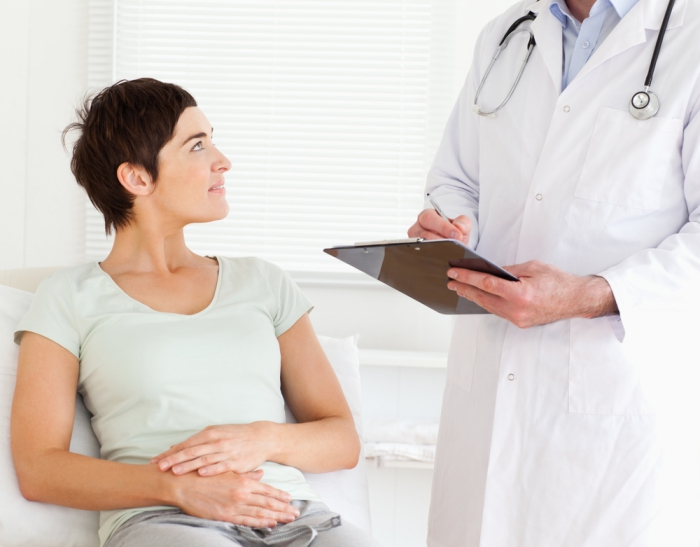 Woman with yeast infection looking at doctor