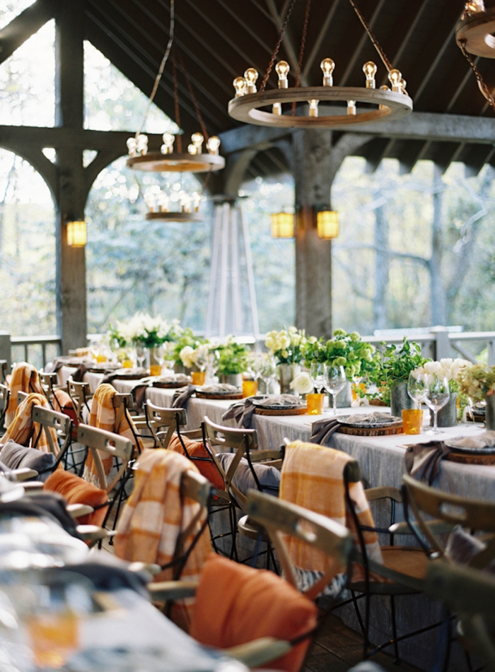 blanket on the back of each chair autumn wedding ideas restaurant porch interior