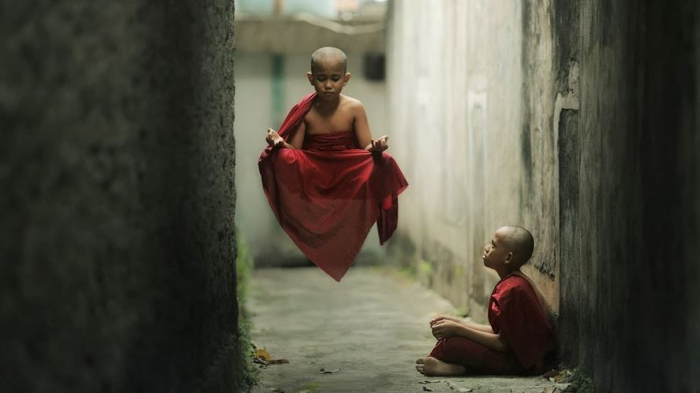 supernormal abilities siddhi - two boys on a street one floating in the air