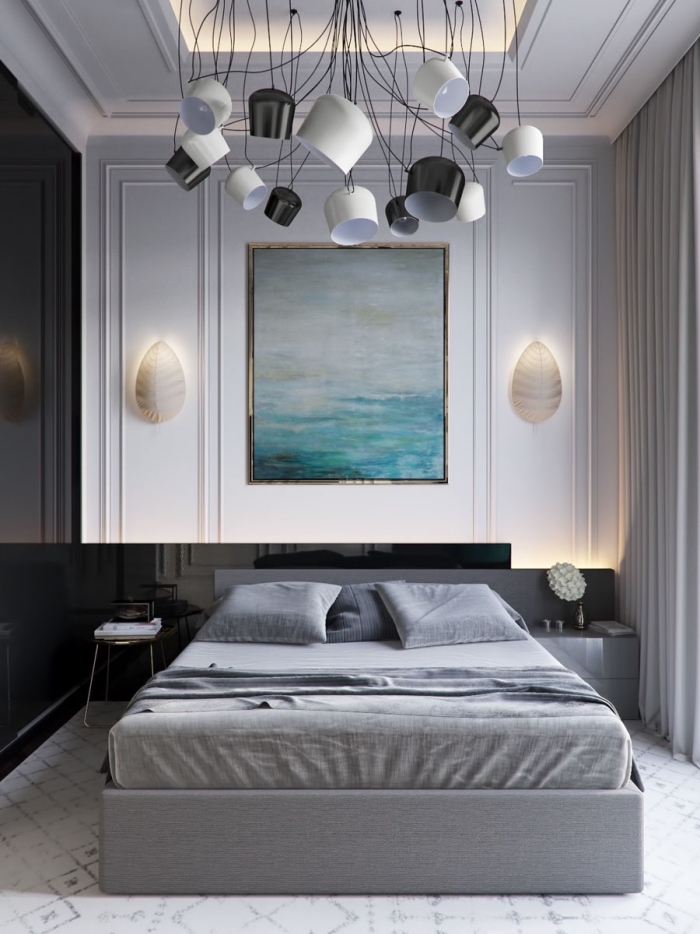 Grey and white modern bedroom with dramatic lighting fixtures and large painting