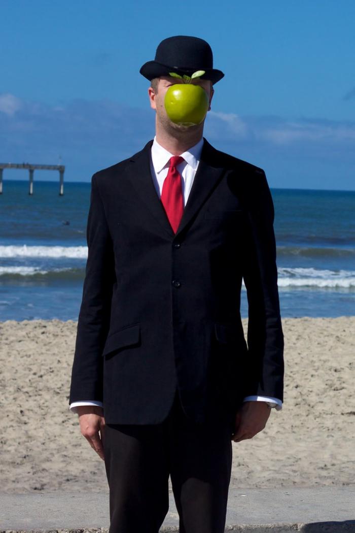 The Son of Man artsy halloween costumes idea man on the beach sea background green apple